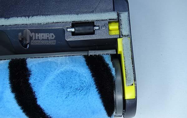 pieza amarilla para retirar cepillo de cabeza motorizada en aspirador Conga